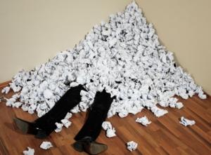 man under paper